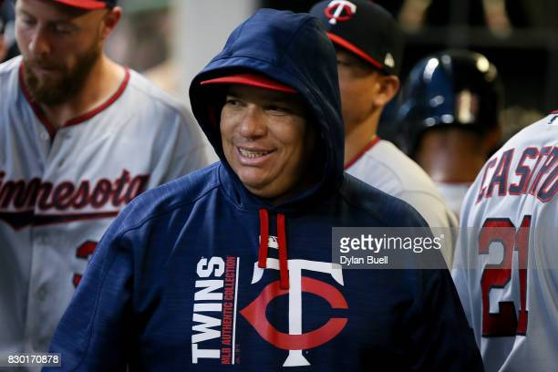 Bartolo Colon of the Minnesota Twins walks through the dugout in the third inning against the Milwaukee Brewers at Miller Park on August 10 2017 in...