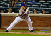 Bartolo Colon of the New York Mets hits a sacrifice bunt in the fourth inning against the Philadelphia Phillies on July 28 2014 at Citi Field in the...