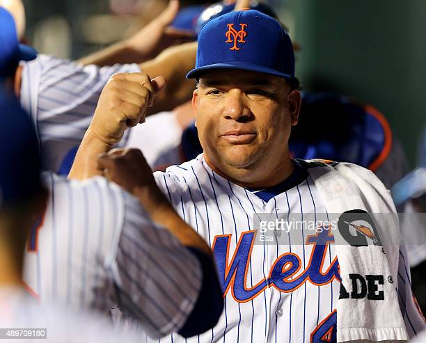 Bartolo Colon of the New York Mets is greeted by teammates in the dugout before the game against the Atlanta Braves on September 23 2015 at Citi...