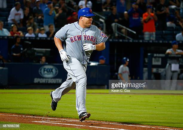 Bartolo Colon of the New York Mets runs to first base after hitting a RBI single in the fourth inning against the Atlanta Braves at Turner Field on...