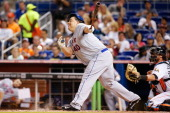 Bartolo Colon of the New York Mets swings at the ball and misses during the sixth inning of the game against the New York Mets at Marlins Park on May...