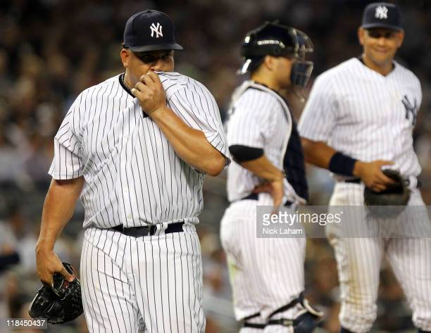 Bartolo Colon of the New York Yankees comes out of the game in the sixth inning against the Tampa Bay Rays at Yankee Stadium on July 7 2011 in the...