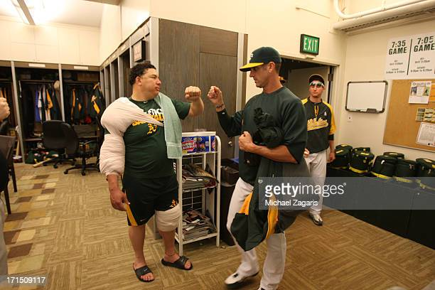 Bartolo Colon of the Oakland Athletics celebrates with Grant Balfour in the clubhouse follwoing the game against the Seattle Mariners at Oco Coliseum...