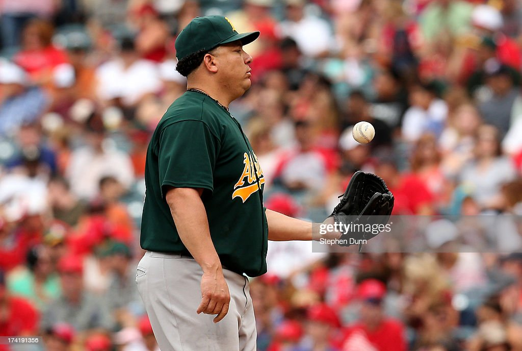 <a gi-track='captionPersonalityLinkClicked' href=/galleries/search?phrase=Bartolo+Colon&family=editorial&specificpeople=175812 ng-click='$event.stopPropagation()'>Bartolo Colon</a> #40 of the Oakland Athletics flips the ball in the air as he pitches against the Los Angeles Angels of Anaheim at Angel Stadium of Anaheim on July 21, 2013 in Anaheim, California. Colon ptiched a complete game shutout as the Athletics won 6-0.