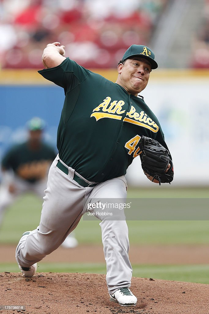 <a gi-track='captionPersonalityLinkClicked' href=/galleries/search?phrase=Bartolo+Colon&family=editorial&specificpeople=175812 ng-click='$event.stopPropagation()'>Bartolo Colon</a> #40 of the Oakland Athletics pitches against the Cincinnati Reds during the game at Great American Ball Park on August 7, 2013 in Cincinnati, Ohio.