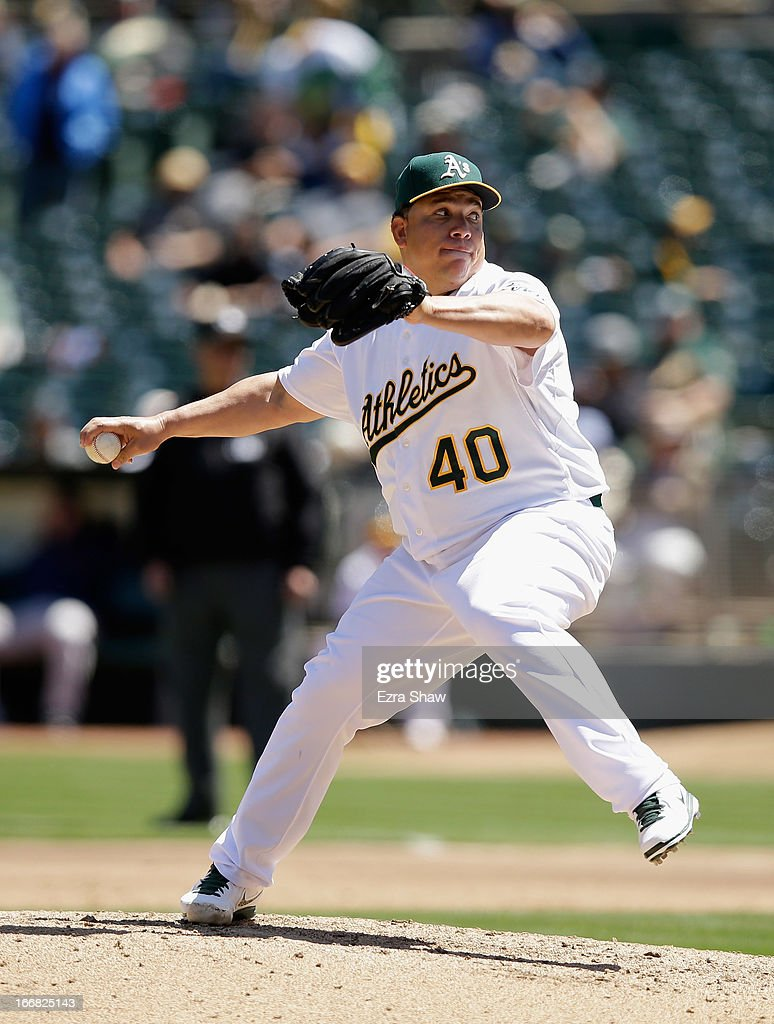 <a gi-track='captionPersonalityLinkClicked' href=/galleries/search?phrase=Bartolo+Colon&family=editorial&specificpeople=175812 ng-click='$event.stopPropagation()'>Bartolo Colon</a> #40 of the Oakland Athletics pitches against the Houston Astros at O.co Coliseum on April 17, 2013 in Oakland, California.