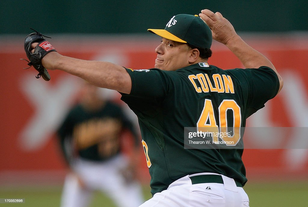 <a gi-track='captionPersonalityLinkClicked' href=/galleries/search?phrase=Bartolo+Colon&family=editorial&specificpeople=175812 ng-click='$event.stopPropagation()'>Bartolo Colon</a> #40 of the Oakland Athletics pitches against the New York Yankees at O.co Coliseum on June 11, 2013 in Oakland, California.