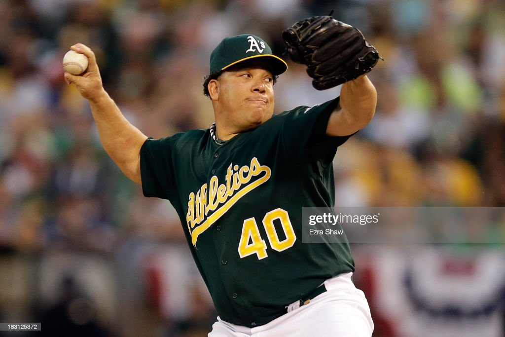 <a gi-track='captionPersonalityLinkClicked' href=/galleries/search?phrase=Bartolo+Colon&family=editorial&specificpeople=175812 ng-click='$event.stopPropagation()'>Bartolo Colon</a> #40 of the Oakland Athletics throws a pitch in the first inning against the Detroit Tigers during Game One of the American League Division Series at O.co Coliseum on October 4, 2013 in Oakland, California.