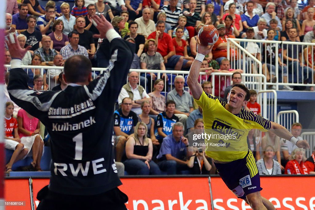 Bartolomiej Jaszka of Berlin scores a goal against Jan Kulhanek of Essen during the DKB Handball Bundesliga match between TUSEM Essen and Fueches Berlin at the Sportpark Am Hallo on September 9, 2012 in Essen, Germany.