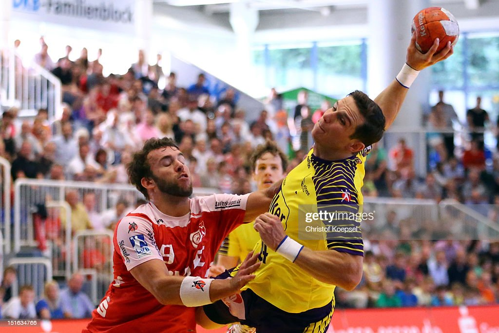 Bartolomiej Jaszka of Berlin scores a goal against Philipp Poeter of Essen during the DKB Handball Bundesliga match between TUSEM Essen and Fueches Berlin at the Sportpark Am Hallo on September 9, 2012 in Essen, Germany.