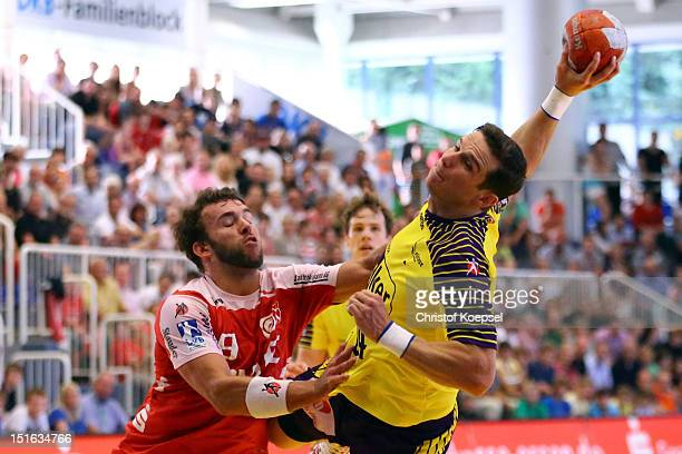 Bartolomiej Jaszka of Berlin scores a goal against Philipp Poeter of Essen during the DKB Handball Bundesliga match between TUSEM Essen and Fueches...