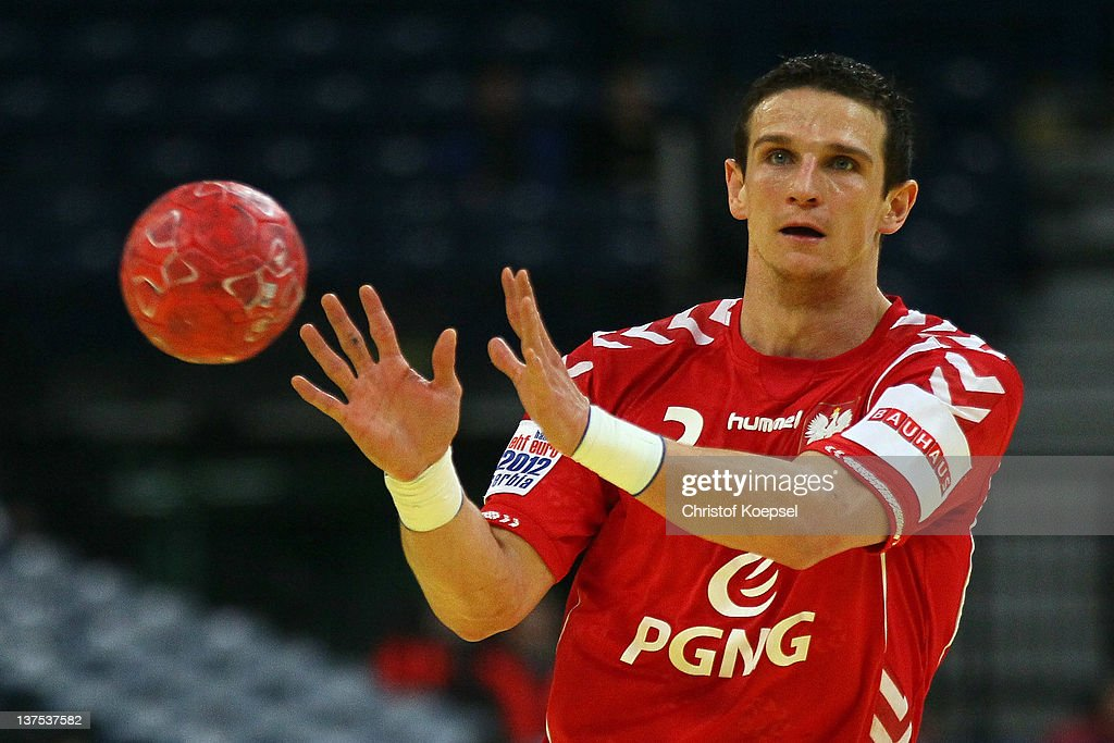 Bartolomiej Jaszka of Poland passes the ball during the Men's European Handball Championship second round group one match between Poland and Sweden at Beogradska Arena on January 21, 2012 in Belgrade, Serbia.