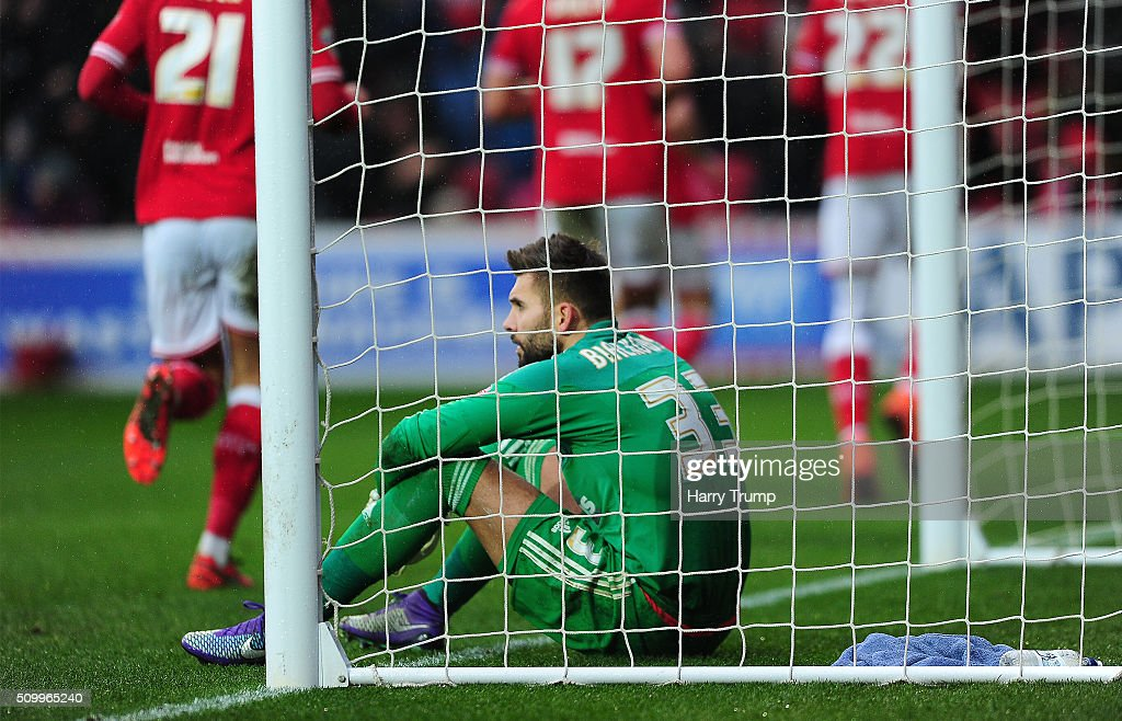 Bartosz Bialkowski of Ipswich Town shows dejection as Aden Flint of Bristol City(not pictured) celebrates his sides second goal during the Sky Bet Championship match between Bristol City and Ipswich Town at Ashton Gate on February 13, 2016 in Bristol, England.