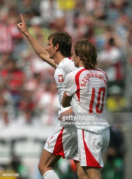 Bartosz Bosacki celebrates after equalising for Poland