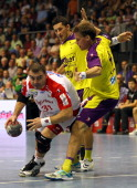 Bartosz Jurecki of Magdeburg and Torsten Laen of Berlin compete for the ball during the Toyota Handball Bundesliga match between SC Magdeburg and...