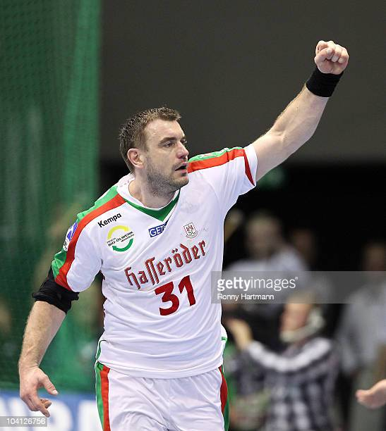 Bartosz Jurecki of Magdeburg celebrates during the Toyota Handball Bundesliga match between SC Magdeburg and Rhein Neckar Loewen at the Boerdeland...