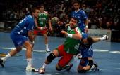 Bartosz Jurecki of Magdeburg is challenged by Robert Gunnarsson of Gummersbach during the Toyota Handball Bundesliga match between VfL Gummersbach...