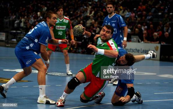 Bartosz Jurecki of Magdeburg is challenged by Robert Gunnarsson of Gummersbach during the Toyota Handball Bundesliga match between VfL Gummersbach...