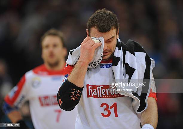 Bartosz Jurecki of Magdeburg looks dejected during the Bundesliga match between Hamburger SV and SC Magdeburg at the O2 world on February 12 2013 in...