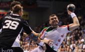Bartosz Jurecki of Magdeburg scores during the Toyota Handball Bundesliga match between SC Magdeburg and THW Kiel at the Boerdeland Hall on May 4...