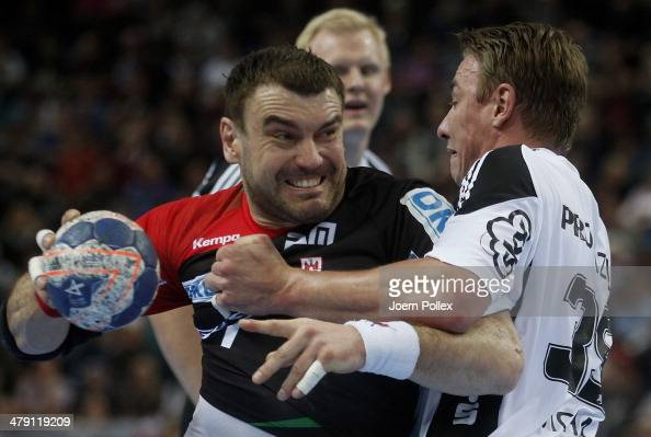 Bartosz Jurecki of Magedeburg is challenged by Filip Jicha of Kiel during the Bundesliga handball match between THW Kiel and SC Magdeburg at the...