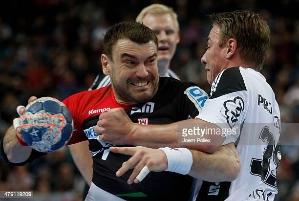 Bartosz Jurecki of Magedeburg is challenged by Filip Jicha of Kiel during the Bundesliga handball match between THW Kiel and SC Magdeburg at the...