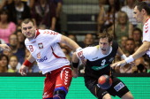 Bartosz Jurecki of Poland and Uwe Gensheimer of Germany compete during the IHF World Championship 2015 Playoff Leg Two between Germany and Poland at...