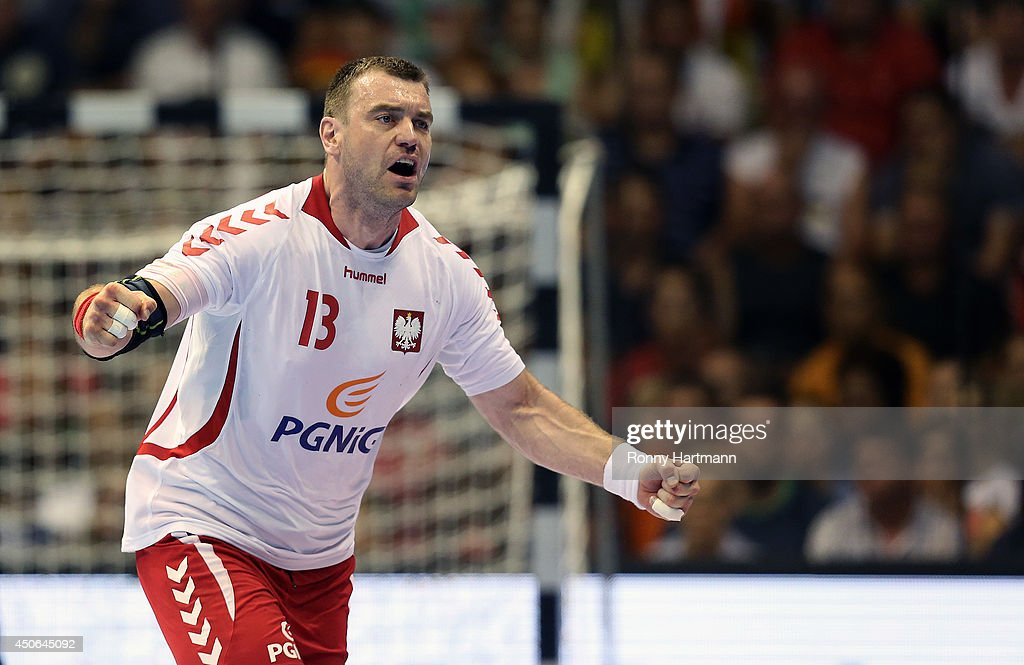 <a gi-track='captionPersonalityLinkClicked' href=/galleries/search?phrase=Bartosz+Jurecki&family=editorial&specificpeople=784556 ng-click='$event.stopPropagation()'>Bartosz Jurecki</a> of Poland celebrates scoring during the IHF World Championship 2015 Playoff Leg Two between Germany and Poland at Getec-Arena on June 14, 2014 in Magdeburg, Germany.