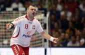 Bartosz Jurecki of Poland celebrates scoring during the IHF World Championship 2015 Playoff Leg Two between Germany and Poland at GetecArena on June...