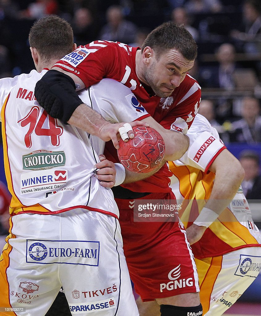 Bartosz Jurecki (R) of Poland competes with Velko Markoski (L) of Macedonia, during the Men's European Handball Championship 2012 second round group one, match between Poland and Macedonia, at Arena Hall on January 23, 2012 in Belgrade, Serbia.