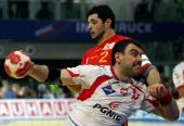 Bartosz Jurecki of Poland in action with Alberto Entrerrios of Spain during the Men's Handball European main round Group II match between Poland and...