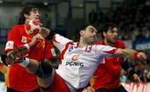 Bartosz Jurecki of Poland in action with Viran Morros de Argila of Spain during the Men's Handball European main round Group II match between Poland...