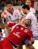 Bartosz Jurecki of Poland is challenged by Daniel Kubes and Jiri Vitek of Czech Republic during the Men's Handball European main round Group II match...