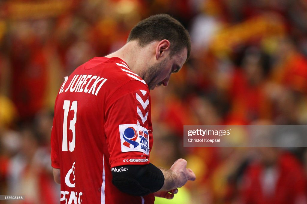 Bartosz Jurecki of Poland looks dejected after losing 25-27 the Men's European Handball Championship second round group one match between Poland and Macedonia at Beogradska Arena on January 23, 2012 in Belgrade, Serbia.