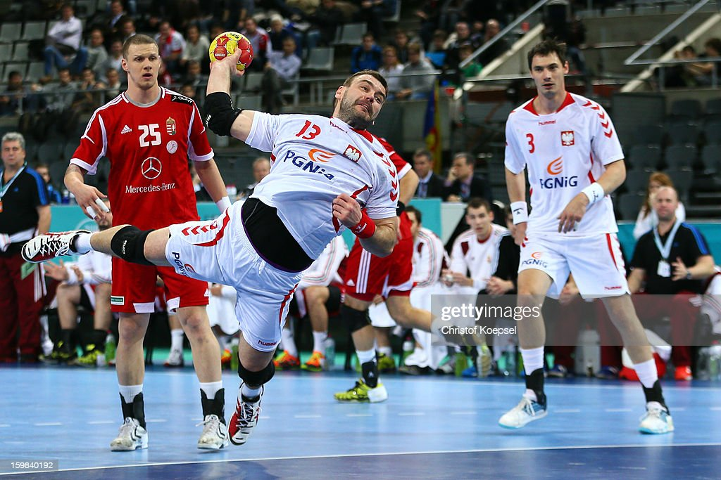 Bartosz Jurecki of Poland (R) scores a goal against Szabolcs Zubai of Hungary (L) during the round of sixteen match between Hungary and Poland at Palau Sant Jordi on January 21, 2013 in Barcelona, Spain.