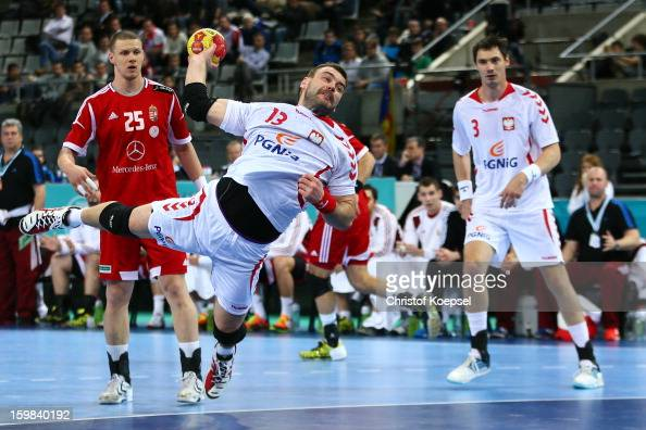 Bartosz Jurecki of Poland scores a goal against Szabolcs Zubai of Hungary during the round of sixteen match between Hungary and Poland at Palau Sant...