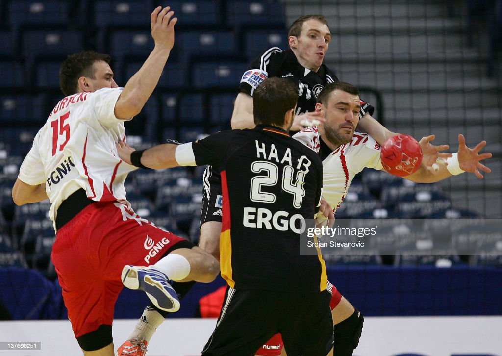 Bartosz Jurecki (R) of Poland vies with Holger Glandorf (L) of Germany during the Men's European Handball Championship 2012 second round group one match between Poland and Germany at Arena Hall on January 25, 2012 in Belgrade, Serbia.