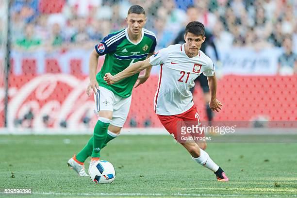 Bartosz Kapustka of Poland and Chris Baird of Northern Ireland during the UEFA Euro 2016 group C match between Poland and Northern Ireland at the...