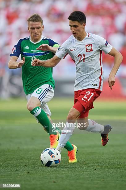 Bartosz Kapustka of Poland and Steven Davis of Northern Ireland during the UEFA Euro 2016 group C match between Poland and Northern Ireland at the...