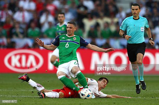 Bartosz Kapustka of Poland fouls Chris Baird of Northern Ireland resulting in an yellow card during the UEFA EURO 2016 Group C match between Poland...