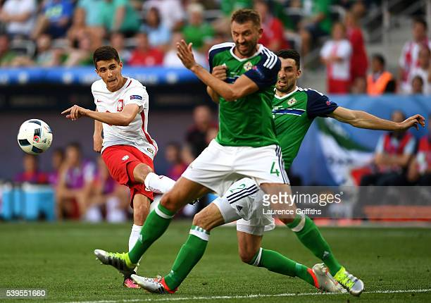 Bartosz Kapustka of Poland shoots at goal during the UEFA EURO 2016 Group C match between Poland and Northern Ireland at Allianz Riviera Stadium on...