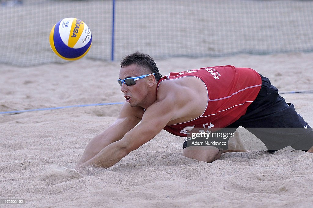 Bartosz Losiak of Poland saves the ball during Day 2 of the FIVB World Championships on July 2, 2013 in Stare Jablonki, Poland.