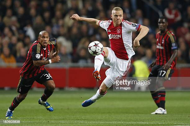 Bartosz Salamon of AC Milan Kolbeinn Sigthorsson of Ajax Cristian Zapata of AC Milan during the Champions League match between Ajax Amsterdam and AC...