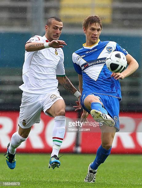 Bartosz Salamon of Brescia Calcio competes for the ball with Gianluca Litteri of Ternana Calcio during the Serie B match between Brescia Calcio and...