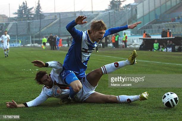 Bartosz Salamon of Brescia Calcio is challenged by Gianmario Comi of Reggina Calcio during the Serie A match between Brescia Calcio and Reggina...