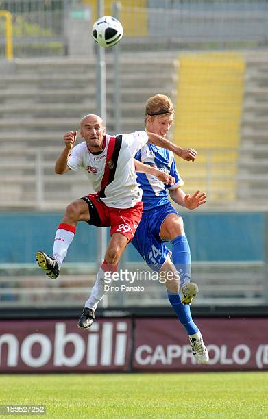 Bartosz Salamon of Brescia jumps for a header with Ilyas Zeytulaev of Virtus Lanciano during the Serie B match between Brescia and Virtus Lanciano at...