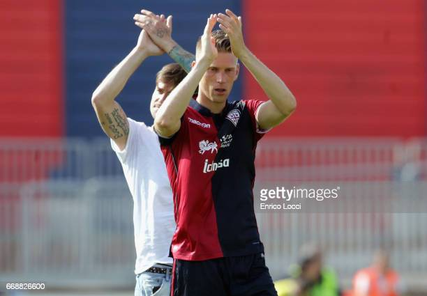 Bartosz Salamon of Cagliari greets thesupporters at the end of the Serie A match between Cagliari Calcio and AC ChievoVerona at Stadio Sant'Elia on...