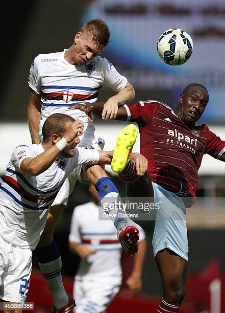 Bartosz Salamon of Samdoria wins a header from Carlton Cole of West Ham United during the preseason friendly match between West Ham United and...