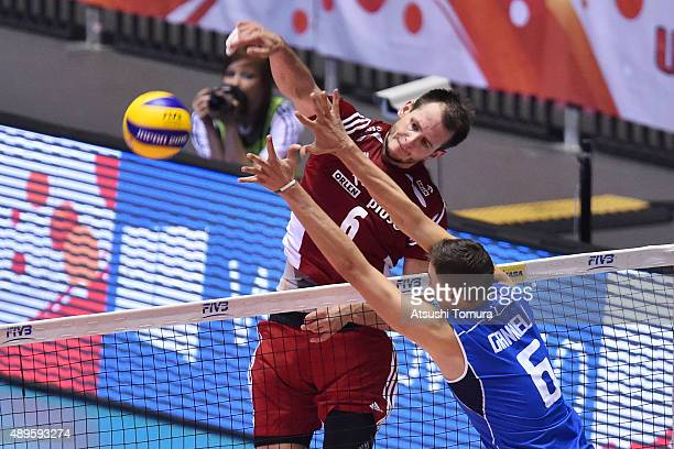 Barttosz Kurek of Poland spikes the ball in the match between Italy and Poland during the FIVB Men's Volleyball World Cup Japan 2015 at Yoyogi...