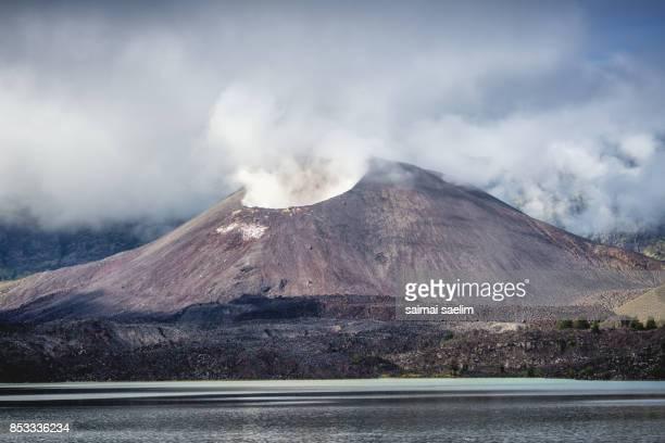Barujari active volcano mountain or baby Rinjani with Segara Anak lake , Lombok island, Indonesia